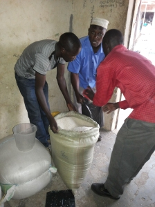 Rice Dealers selling rice to a customer. Nabiganda, Butaleja District.